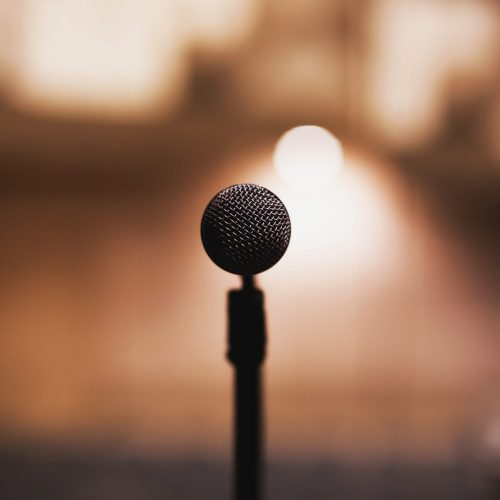Canva - Microphone on Stage in a Concert